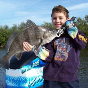 child with black drum